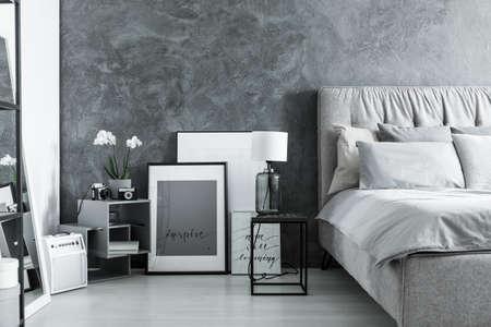 Gray bedroom with retro radio, camera, posters and handmade vase lamp Stok Fotoğraf
