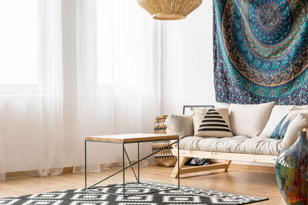Living room in ethnic style with simple modern sofa