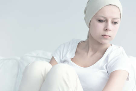 Girl with cancer looking away in resignation Reklamní fotografie - 83611214
