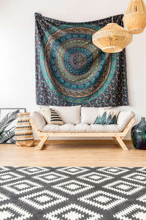 Ethnic living room with mandala pattern on the wall