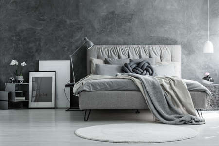 Loft style bedroom with gray design, concrete wall and modern furniture