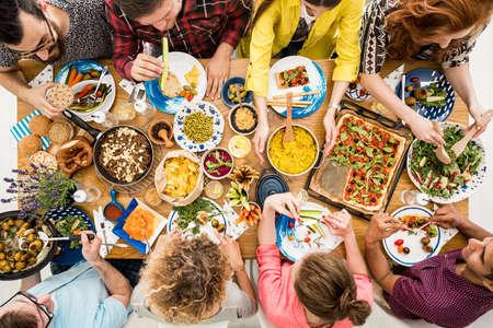 Vegetarians enjoy tasty dish which consists of hummus, salad, bulgur groats and vege pizza