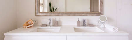 modern bathroom: Bright bathroom interior with two sinks and square mirror