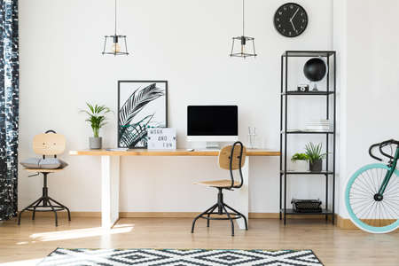 Minimalistic office design for remote workers with wooden chairs, potted plants and plain metal rack
