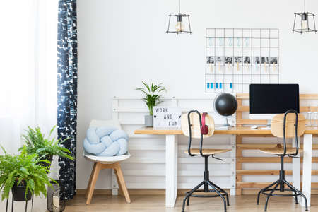 home office interior: Double desk in simple white study designed for a young student and his freelancer girlfriend Stock Photo