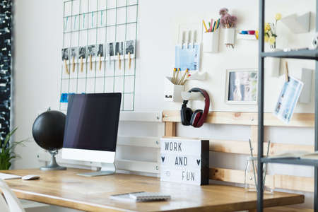Side angle of creative desk with modern office equipment in start-up company Imagens