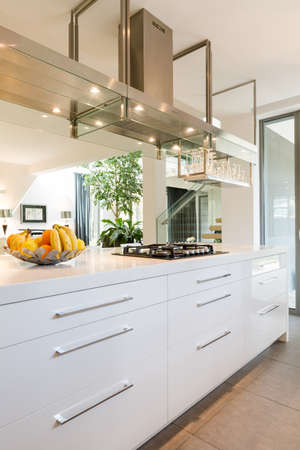 Cropped shot of a white kitchen furniture in the minimalistic kitchen interior