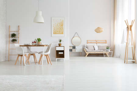 Trendy designed dining and living rooms in white lagom style