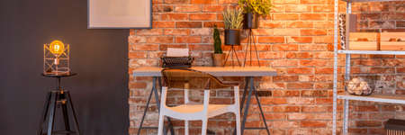 home office interior: Raw, industrial loft interior with brick wall Stock Photo