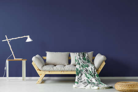 Dark blue colored living room interior in minimalistic scandi style