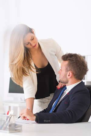Attractive woman has an affair with a man at work photo