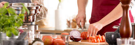 Young woman preparing delicious homemade tomato sauce for pasta Standard-Bild