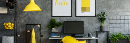 Dark office room with plants and yellow elements