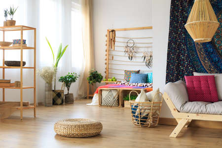 Modern roomy apartment designed in ethnic ethereal style Stock Photo