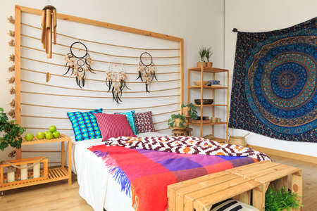 Colorful bedroom designed in ethnic ethereal style Stock Photo
