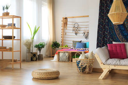 Ethereal ethnic multicolor roomy apartment interior design Stock Photo