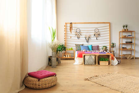 Roomy bedroom with ethnic ethereal bed decoration