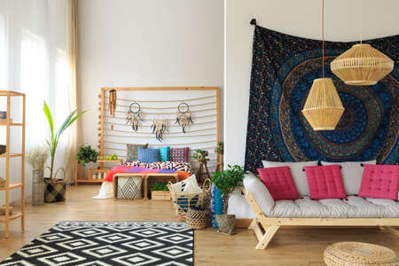Ethereal ethnic multicolor apartment interior with bed and sofa