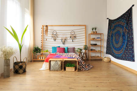 Big bedroom with multicolor ethnic ethereal design Stock Photo
