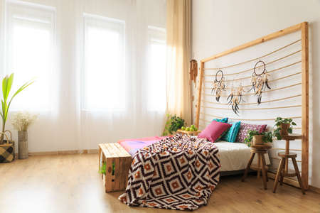 Roomy bedroom with big bed with bedhead with dreamcatchers