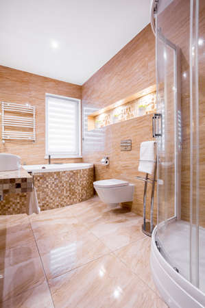 Sandstone fancy bathroom with bath and shower