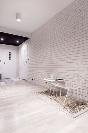 White hallway with brick wall in stylish apartment