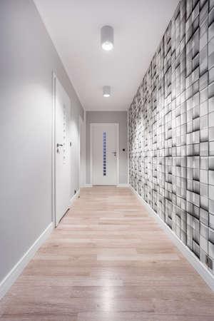 Simple corridor with geometric wallpaper in modern flat Stock Photo