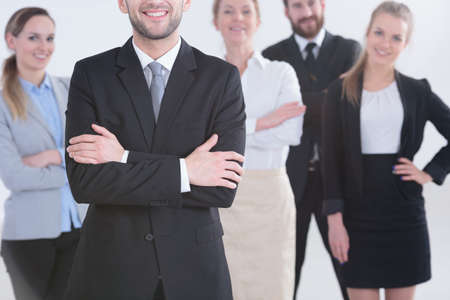 Professional smiling office workers standing in a group Stock Photo - 84520353
