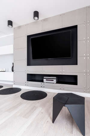 Fancy gray entertainment zone with TV and stereo