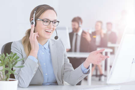 Friendly professional woman working as call center representative