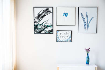 White wall with pictures with plant motif