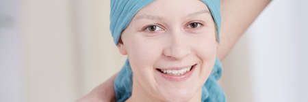 Happy young woman living normally despite having cancer