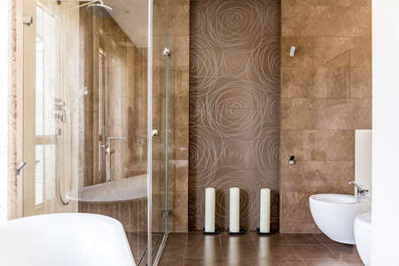 Fancy bathroom with brown decorative tiles with abstract pattern and candles 版權商用圖片