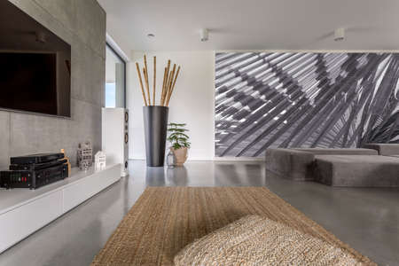 Interior of modern day room with a large abstract painting