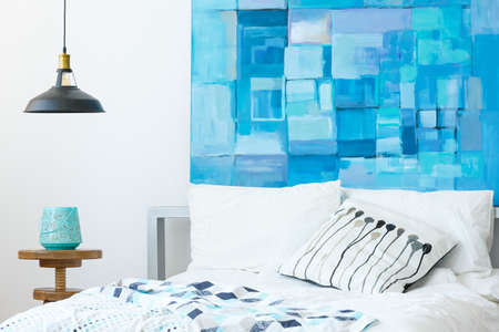 White and blue glamor bedroom interior with modern abstract painting