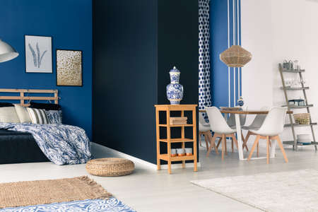Blue and white open loft with cobalt porcelain
