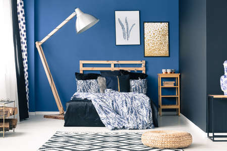 Modern bedroom in shades of blue with gold accents Stock Photo