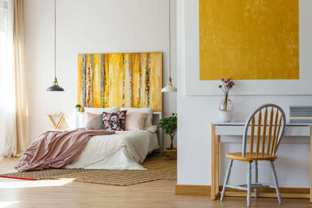Functional and calming bedroom with office space and stylish decor