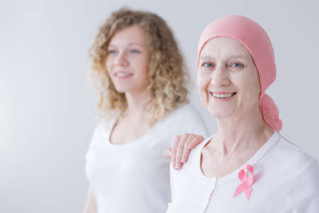 Caring daughter supporting mother during her breast cancer treatment