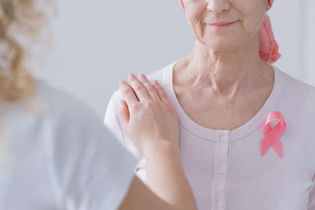 Mother and daughter expressing intergenerational breast cancer awareness Stock Photo