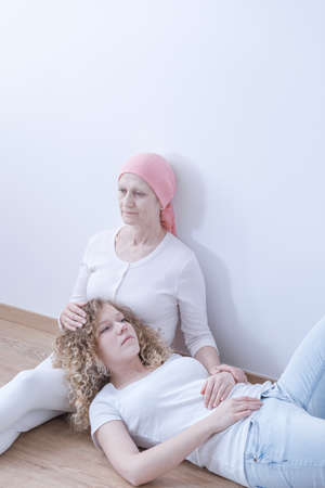Worried mother battling malignant cancer spending time with daughter Stock Photo