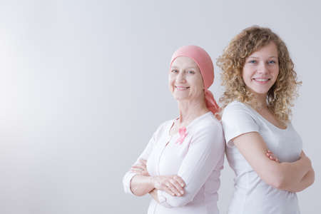 Daughter with smiling breast cancer mother staying strong and positive