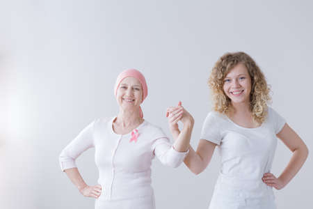 Mother and daughter supporting each other during breast cancer battle Imagens