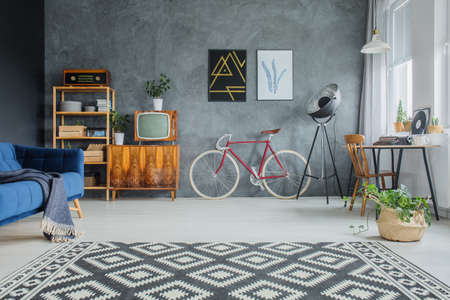 Black and white carpet with geometric pattern placed on living room floor Stok Fotoğraf