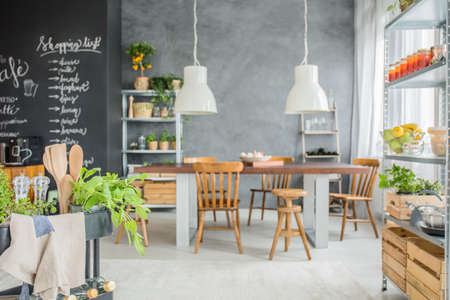 Family home with chalkboard wall, big table and fresh food Stock Photo