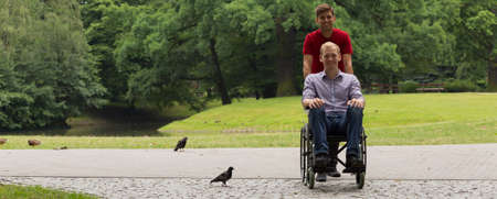 Disabled man spending time with his friend