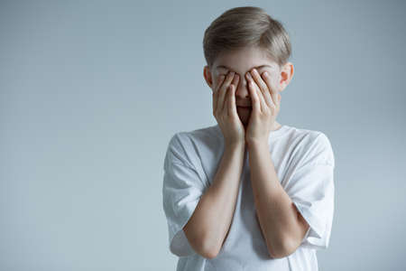 Little boy humiliated and shamed by parent, emotional child abuse