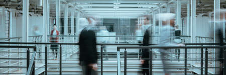 Blurred image of people working in modern office, panorama