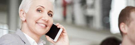 Woman working in big business company, talking on phone, panorama Lizenzfreie Bilder