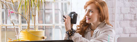 Young beautiful woman taking a photo of a plant Lizenzfreie Bilder